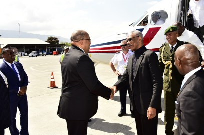President Granger is greeted at the VC Bird International Airport, St. John's, Antigua by Minister of Foreign Affairs of Haiti, Mr. Pierrot Delienne
