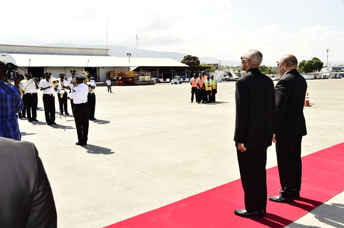 President David Granger and Chairman of the Caribbean Community (CARICOM) and Haiti's Minister of Foreign Affairs, taking the salute at the VC Bird International Airport, St. John's, Antigua during his brief stop over, earlier today