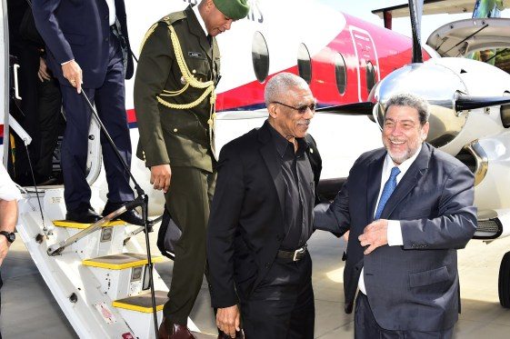 President David Granger and Prime Minister Ralph Gonsalves share a warm moment on the Guyanese Head of State's arrival at the Argyle International Airport.
