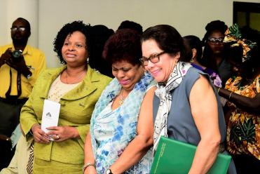 Minister of Social Protection, Ms. Amna Ally flanked by Minister of Public Health, Ms. Volda Lawrence (left) and First Lady Mrs. Sandra Granger as they share a light moment at the event