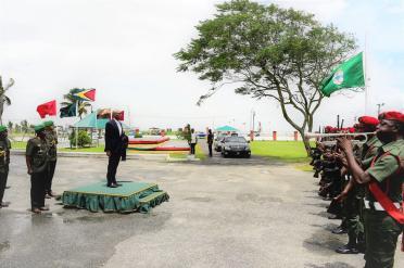 President David Granger receiving the Presidential salute upon his arrival at Base Camp Ayanganna