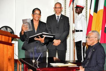 Ms. Carol Khan-James taking her Oath of Office in the presence of President David Granger