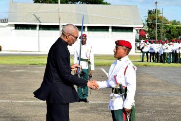President David Granger presenting best graduating student, Second Lieutenant Francisco Choc with the Sword of Honour