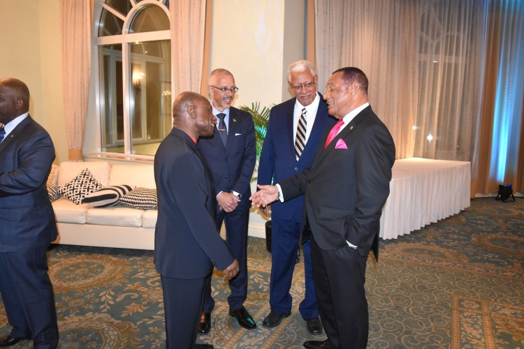 Minister of Foreign Affairs, Mr. Carl Greenidge, Minister of Agriculture, Mr. Noel Holder and Minister of Business, Mr. Dominic Gaskin sharing a light moment with Prime Minister Perry Christie