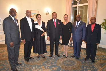 From left; Chief Justice of the Bahamas, Mr. Hartman Longley, President David Granger, Governor-General of The Bahamas, Dame Marguerite Pindling, Prime Minister Perry Christie and Mrs. Christie, Deputy Prime Minister and Minister of Works and Urban Development, Mr. Philip E. Brave Davis and Minister of Foreign Affairs of Guyana, Mr. Carl Greenidge just before joining guests at the official State Dinner at the British Colonial Hilton Nassau