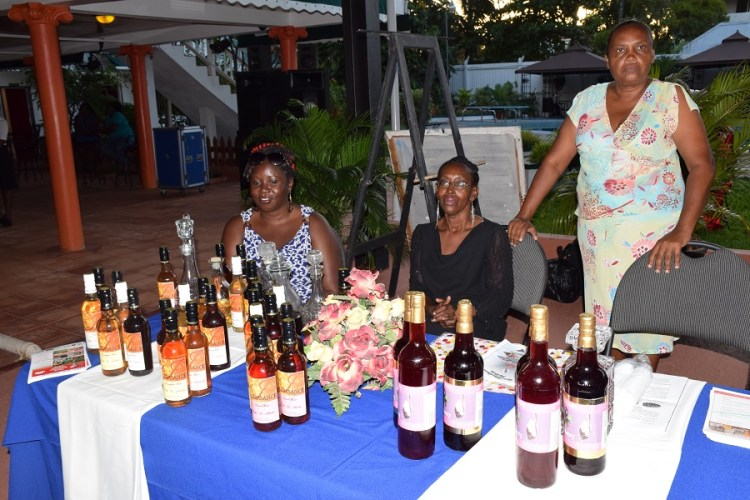 Members of the Women's Agro-Processors Development Network displaying their products