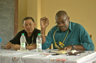 Minister of Public Infrastructure, David Patterson (right) makes a point during a meeting with residents and regional executives of Moruca, Region 1. With him is Minister of Indigenous Peoples' Affairs, Sydney Allicock