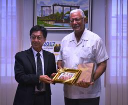 Agriculture Minister, Noel Holder receives a keepsake from Tailand's Chargé ď Affairs, Mr. Teerapong Vanichanon