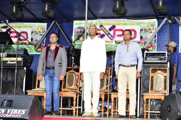 Dear land of Guyana! President David Granger, President of the Region Five Chamber of Industry and Commerce, Mr. Imran Saccoor and Regional Chairman, Mr. Vickchand Ramphal stand at attention for the National Anthem