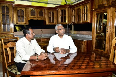 President David Granger sitting with proprietor of Bunny and Sons, a household furniture and fixtures store in Region Five. The Head of State seemed taken with the quality of work on display