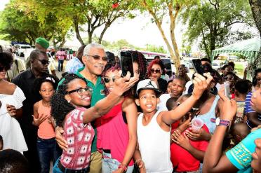 Selfie time! A group of youngsters take a selfie with President David Granger