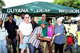 President David Granger poses with members of the Guyana Deaf Mission in the National Park on Easter Monday