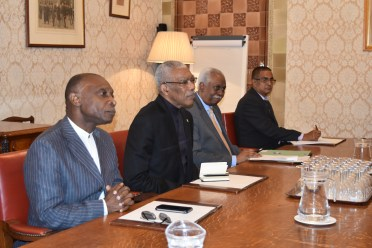 President Granger, Minister of Foreign Affairs, Mr. Carl Greenidge and Guyana's High Commissioner to the UK, Mr. Hamley Case listen intently during the meeting