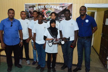 Director of the Sports, Mr. Christopher Jones (first, right) and the team with their robot