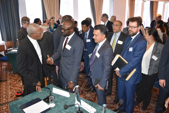 Investors queued up to speak one on one with President David Granger, following the formal presentations. Here the Head of State is pictured in discussion with Director at ION Geophysical, Mr. Folarin Lajumoke