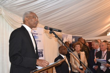 President David Granger tells British national and multilateral investors that Guyana is an exciting prospect as Baroness Anelay listens intently