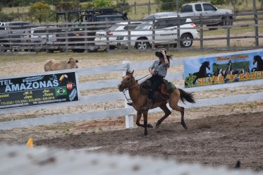 One of the young cowgirls showing the audience her horse riding skills in the ring at the Rupununi Rodeo