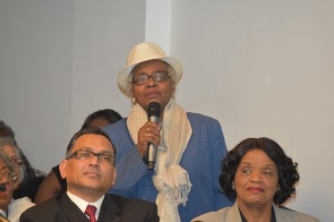 A London-based Guyanese makes a point during the question and answer segment of the meeting