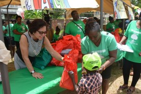 This little boy holds on to his hamper as First Lady, Mrs. Sandra Granger interacts with him