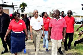 President David Granger bring escorted into the Local Government Officers Union's office by its President's Ms. Wendy De Cunha (left)