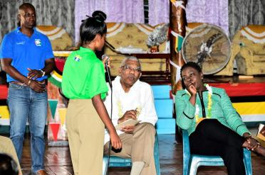 President David Granger and Minister of Education, Ms. Nicolette Henry listening to the concerns of this student at the New Opportunity Corp