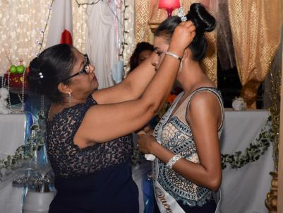 Mrs. Sita nagamootoo crowning the 2017 homecoming queen at the J.C Chandisingh 21 years of alumni in Corentyne, Berbice