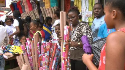 Lynette Maxwell in the bustle to get last minute school supplies of stationary and book wrapping paper for her three children, downtown Georgetown