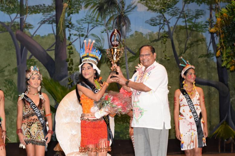 Prime Minister Moses Nagamootoo presenting the trophy to the new Miss Indigenous Heritage Queen