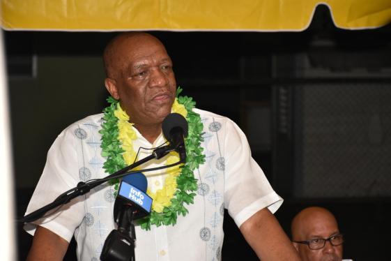 Minister of State Joseph Harmon addressing residents of Mocha Arcadia on Sunday