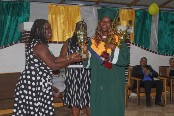 Valedictorian Tamesha Lewis receives her trophies from Principal of the New Amsterdam Technical Institute, Maxine Thompson