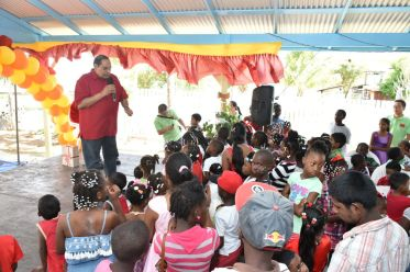 Prime Minister Moses Nagamootoo chatting with the children at the Christmas party