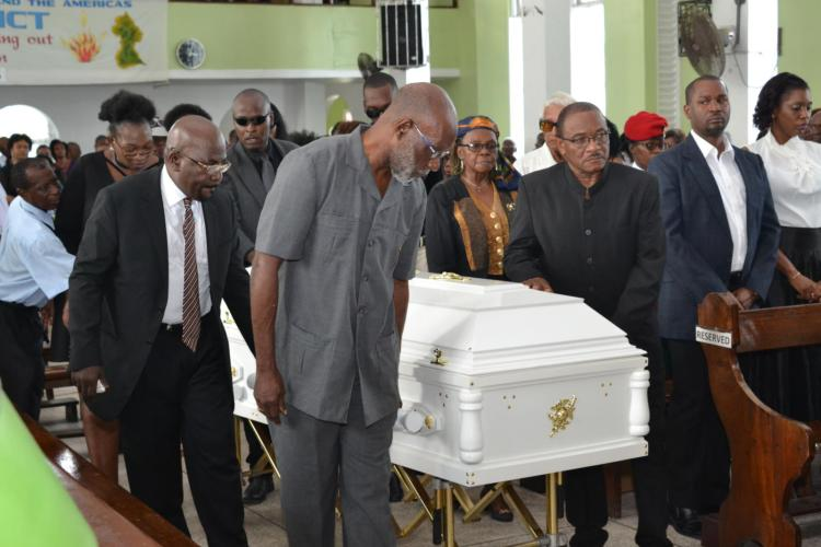 Technical Advisor, Tertiary Education to the Minister of Education, Vincent Alexander along with other pall-bearers taking Sandra Jones' body to the front of the church