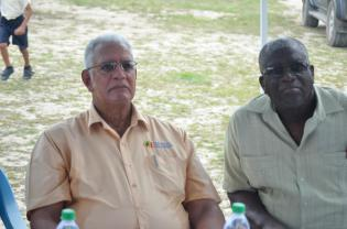Minister Holder and Mr. Cumberbatch listen attentively to the concerns of the residents