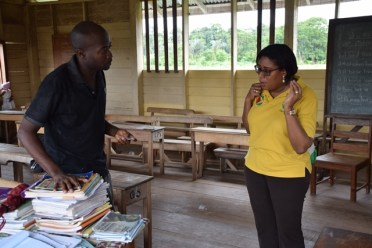 Hon. Catherine Hughes, Minister of Public Telecommunications in conversation with Head teacher of Fairview Primary, Quado Vancooten