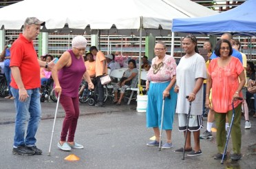 Persons taking part in the assisted device race