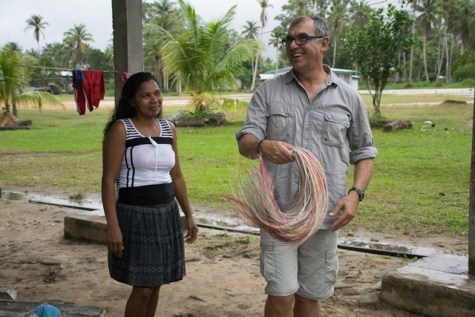 Wilderness Explorers Chairman, Tony Thorne sharing a moment with one of the women involved in craft in the village