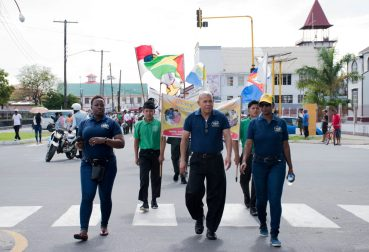 Minister of Social Cohesion with responsibility for Culture, Youth and Sport Dr. George Norton (center) leading the Youth Rally with Director of Youth Melissa Carmichael-Haynes (left) and Assistant Director of Youth Leslyn Boyce