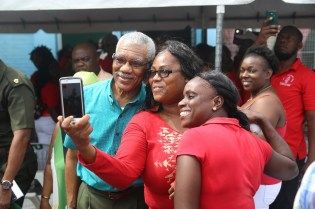President David Granger sharing a photo op with GTU members