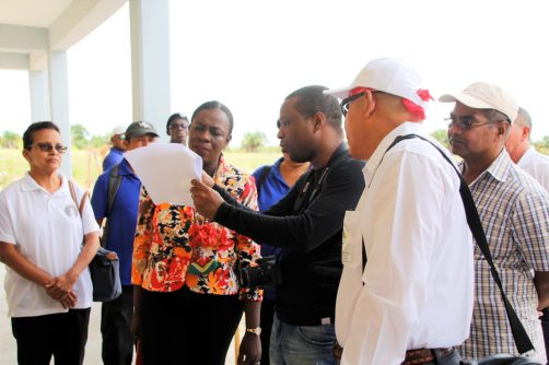 Minister of Education, Hon. Nicolette Henry and Minister of Social Cohesion, Dr. George Norton taking a look at the building plan for the school