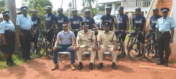 E' Division police ranks pose with Divisional Commander Anthony Vanderhyden (centre sitting) and traffic Inspector Shawn Massey (right) and CID Inspector (left)