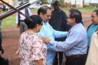 Prime Minister Moses Nagamootoo and Mrs. Sita Nagamootoo being welcomed by Region Nine Regional Chairman, Brian Allicock.