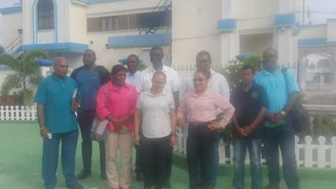 (Front row extreme right) Region One, RHO, Cerdel McWatt followed by REO (ag) Tikaram Bisessar alongside administration officials from Region One. Back row Region Two – REO, Rupert Hopkinson, and DREO, Roop Kumar Persaud, Regional Chairman for Region one Brentnol Ashley with other administration officials