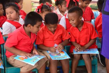 Students of the Arapaima Nursery School with their presents.