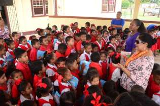 Students and teachers of the Arapaima Nursery School thanking Mrs. Nagamootoo and family for their donation.
