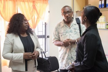 Ministry of Public Health's Focal Point for health services in Region Six, Alex Foster (Centre) interacts with Minister within the Ministry of Public Health, Dr. Karen Cummings along with Director of Regional and Clinical Health Services, Dr. Kay Shako.