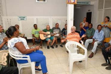 Minister Broomes and the men celebrating Father's Day with singing of songs