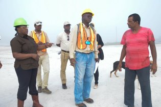 Minister Broomes and GGMC staff in discussion with sandpit operator from Dora Park.