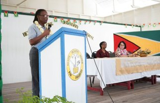 Mrs. Beverly Tapp, Managing Director of B & J Civil Works Speaking to students of the Beterverwagting Secondary School.