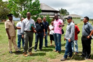 Minister of Indigenous peoples' Affairs, Sydney Allicock, Permanent Secretary, Alfred King and Civil Engineer, Trilloyd Allen at the area identified for the construction of the Green Centre.