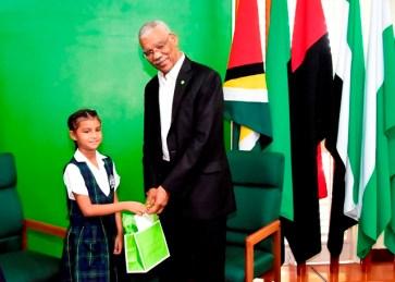 Miss Eliana Ganpat brought a special gift for President David Granger.